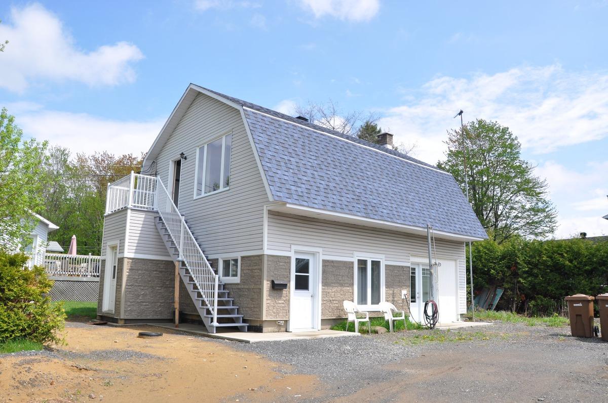 maison paliers multiples vendre drummondville centre du qu bec sutton qu bec. Black Bedroom Furniture Sets. Home Design Ideas